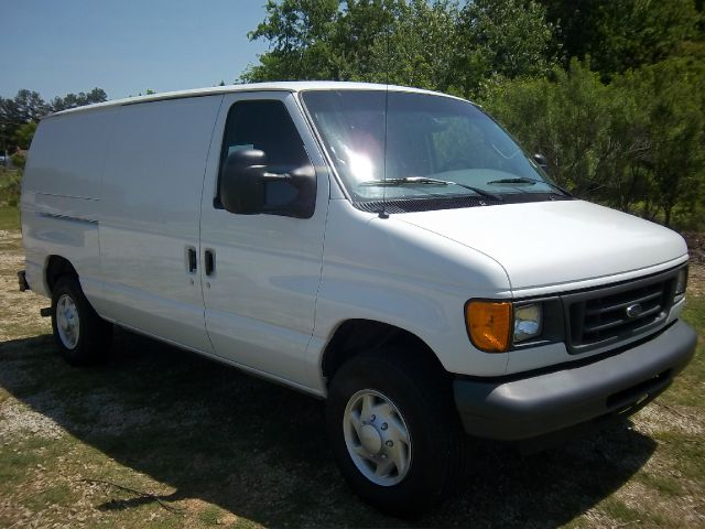 2007 FORD E250 CARGO VAN white nice adrian steel drawers  shelves on both sides you will have n