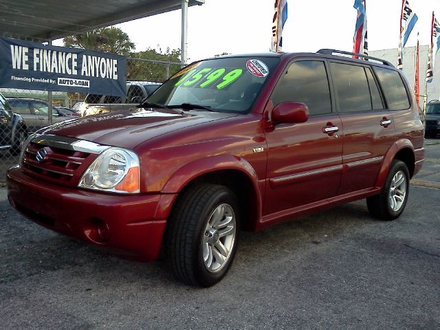 2005 SUZUKI XL-7 red 4wdawdabs brakesair conditioningalloy wheelsamfm radioanti-brake syste