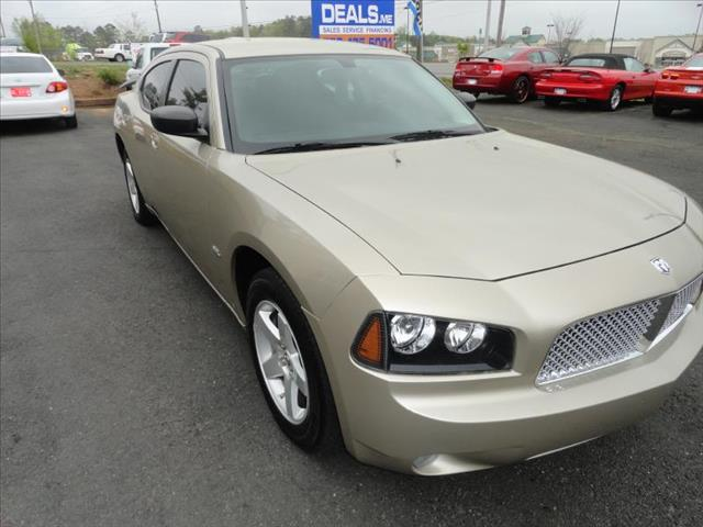 2009 DODGE CHARGER SXT tan come and check it out today lowest prices in the state you wont find