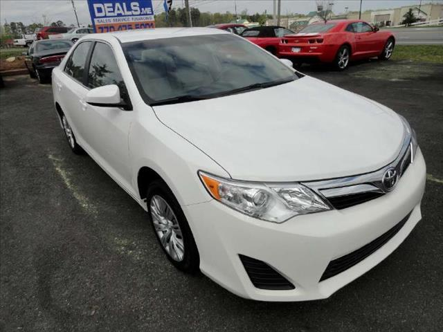 2012 TOYOTA CAMRY LE white come and check it out today lowest prices in the state you wont find