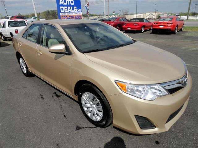 2012 TOYOTA CAMRY LE gold come and check it out today lowest prices in the state you wont find